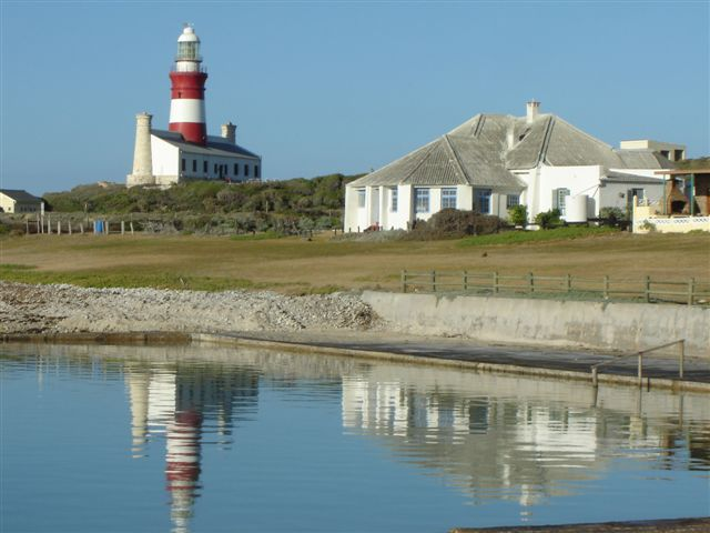 Southermost and Cape Agulhas Lighthouse reflected in the tidal pool